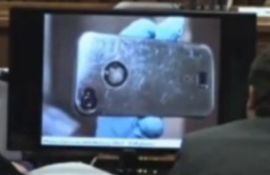phone case of phone found under bathmat near gun