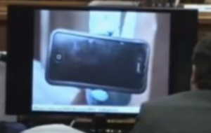 phone found under bathmat near gun