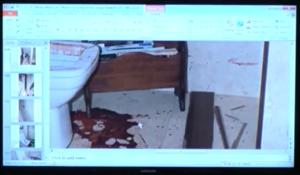blood droplets on floor next ro rack