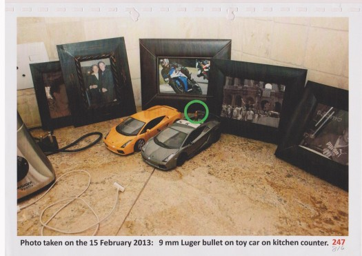 Toy car and bullet in kitchen