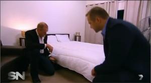 kneeling at bed