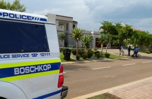 "Police vehicles are parked outside the home of South African ""Blade Runner"" Oscar Pistorius in Pretoria"