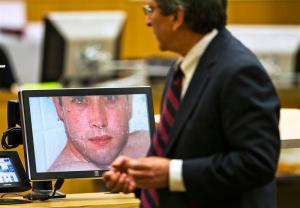 Prosecutor Juan Martinez asks Jodi Arias about a photo she took of Travis Alexander in Maricopa County Superior Court in Phoenix