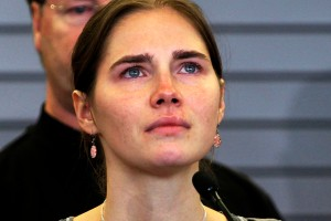 Amanda Knox pauses while speaking during a news conference on arrival from Italy, at Sea-Tac International Airport, Washington in an October 4, 2011 file photo. Knox, the American student who became tabloid fodder, was not in court on January 30, 2014 when Italian judges sentenced Knox to 28 years 6 months in jail in her retrial for the murder of Briton Meredith Kercher when the two were roommates studying abroad in 2007. REUTERS/Anthony Bolante/Files (UNITED STATES - Tags: CRIME LAW HEADSHOT TPX IMAGES OF THE DAY)