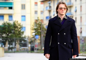 Raffaele Sollecito walks outside Florence court, Italy, Monday, Jan. 20, 2014. A prosecutor urged a court on Monday to take steps to make sure that American Amanda Knox and her former Italian boyfriend Raffaele Sollecito would serve their sentences, if they are convicted of murdering British student Meredith Kercher. Prosecutor Alessandro Crini preceded his request by noting that Knox has remained in the United States for this trial, while co-defendant Raffaele Sollecito has traveled abroad during it. In the case of Sollecito, who told reporters Monday that he intends to remain in Italy for the verdict, the precautionary measures could include immediate arrest, house arrest or the confiscation of his passport. (AP Photo/Francesco Bellini)