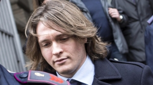 epa04681726 Raffaele Sollecito (C) leaves Italy's highest court building in Rome, Italy, 27 March 2015. Judges from Italy's supreme court retired to deliberate on the murder of British student Meredith Kercher, which has been blamed on US citizen Amanda Knox and her Italian ex-boyfriend Raffaele Sollecito. The Rome-based Court of Cassation was due to issue the fifth - and not necessarily the last - judgement in a legal saga that has protracted for more than seven years. EPA/MASSIMO PERCOSSI